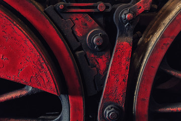 The big, iron wheels of an old steam locomotive