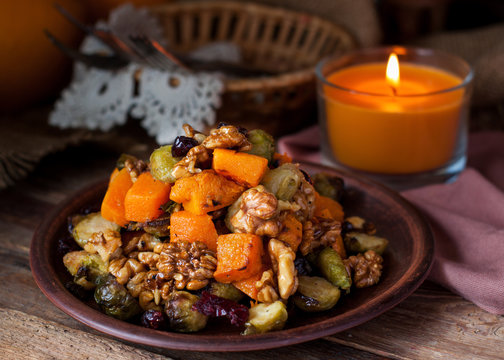 Festive salad with brussels sprout, pumpkin, nuts, cranberries