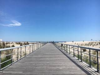 A boardwalk leading to the beach at Robert Moses State Park on Fire Island, New York