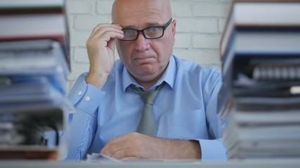 Confident Businessman With Eyeglasses Working in Accounting Archive Room