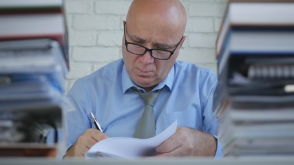 Preoccupied Businessman Working With Documents and Contracts in Office