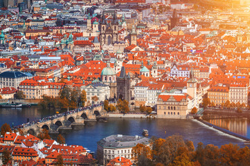 Autumn aerial view of houses and roofs of Prague old city town including Charles bridge. Czech Republic