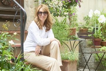 Beautiful mature woman sitting outdoor