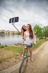 Two beautiful girls taking a selfie