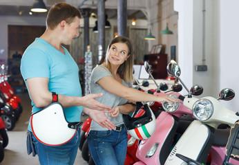 Adult couple is choosing modern motobikes