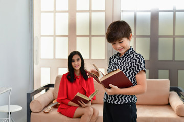 Education Concepts. Mom is teaching her son to study. Family is doing home activities.