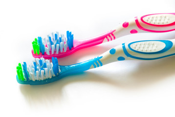 Two toothbrushes isolated on white background