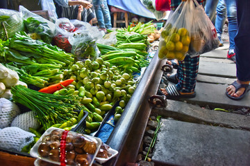 Selling food on the Maeklong Railway market in Thailand