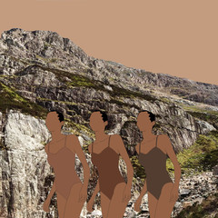 Three women in bathing suits on rocky beach