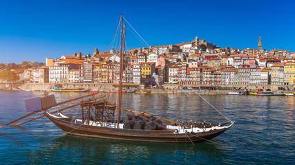 Oporto or Porto city skyline, Douro river, traditional boats and Dom Luis or Luiz iron bridge. Porto, Portugal, Europe.