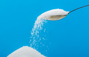 Pouring sugar on a pile of sugar