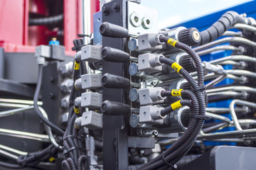 Close up of pipe system of hydraulic valves in agricultural machinery
