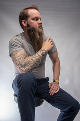 tattoo sleeve on right arm of hipster