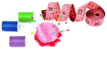 Composition with threads and sewing accessories isolated on white background. Free space for text.