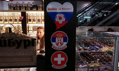 A shop advertises the upcoming soccer match between Serbia and Switzerland during FIFA World Cup in Kaliningrad