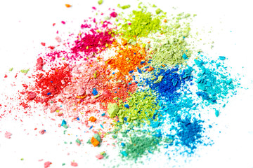 Crumbs of multi-colored chalk on a white background. Joy, Carnival. Panorama. A game for children. Art