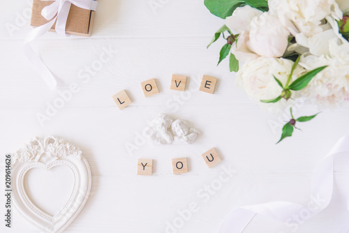 Top view Love you lettering with statuette of two little antique ...