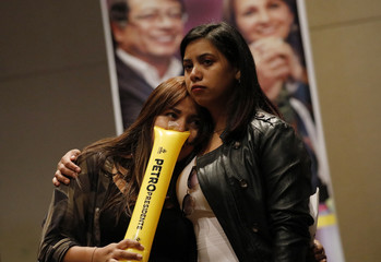 Supporters of presidential candidate Petro react as results are released during the second round of the presidential election in Bogota