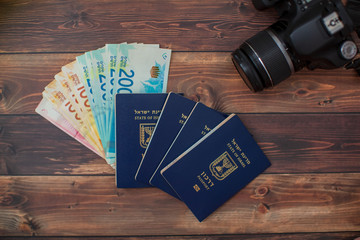 Preparing for a Trip, DSLR, money, passport on wooden table