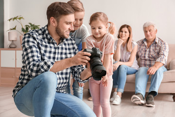 Professional photographer with camera and little kids in studio