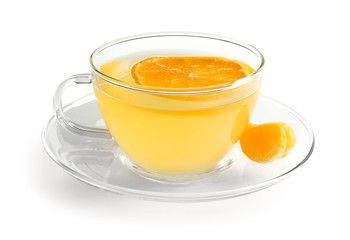 Glass cup of tangerine tea on white background