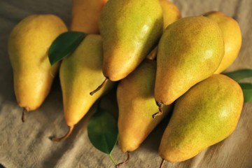Fresh ripe pears on cloth, closeup