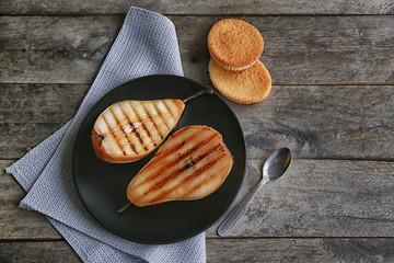 Tasty baked pear on plate
