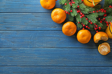 Christmas composition with fresh mandarins on wooden table