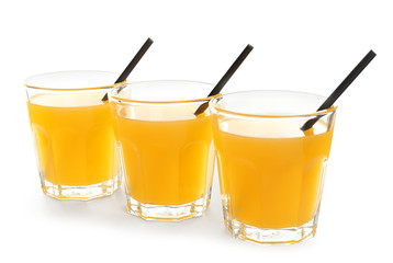 Glasses of tasty citrus juice on white background