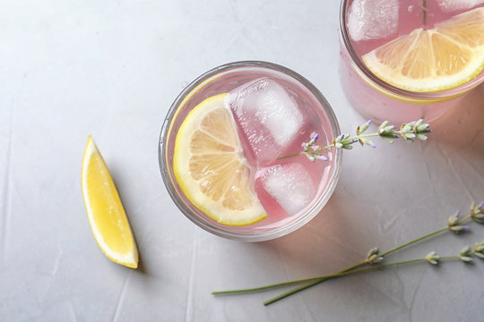 Flat lay composition with natural lemonade on light background