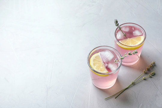 Natural lemonade with lavender in glasses on light background