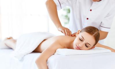 beautiful girl enjoys massage and spa treatments