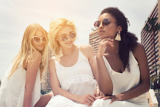 Group of multiracial girlfriends having fun together.