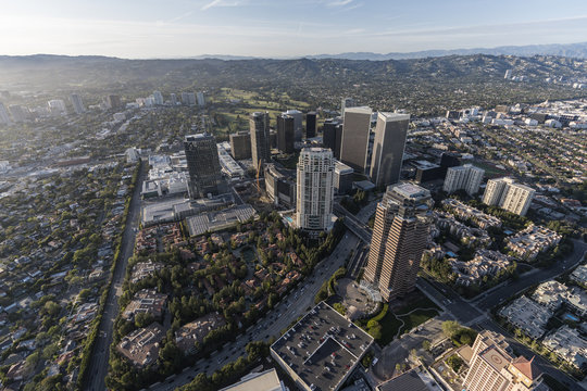 Aerial view of Century City towers with the Santa Monica Mountains in background in scenic Los Angeles California.