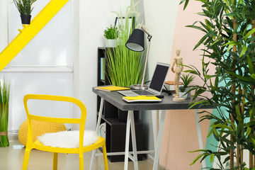 Comfortable workplace in interior of beautiful modern room