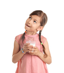 Cute little girl with glass of milk on white background