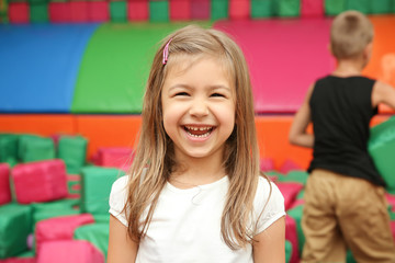 Cute girl in entertainment center