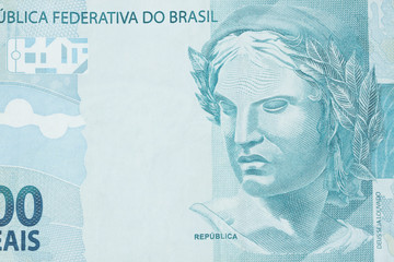 Republic's Effigy portrayed as a bust on Brazilian money. Super macro closeup on one hundred bill. Concept of economy, inflation and business.