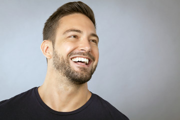 Handsome man laughing, a face portrait