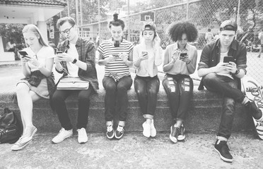 Young adult friends using smartphones