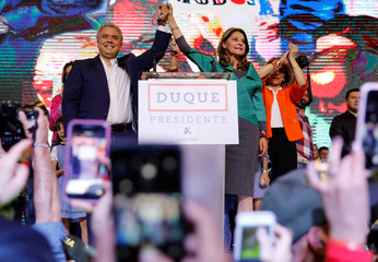 Presidential candidate Duque celebrates with his candidate for Vice President Ramirez after winning the presidential election in Bogota