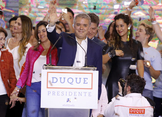 Colombian candidate Duque greets supporters after he won Colombia's presidential election in Bogota