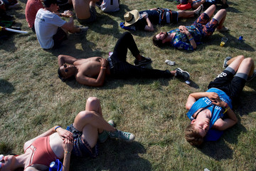 Revelers slumber in front of acts staring at the main concert stage on the fourth and final day of the Firefly Music Festival in Dover, Delaware U.S.