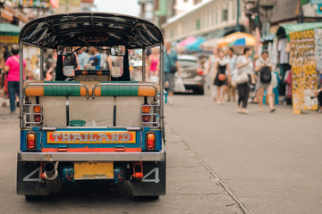 Poster Bangkok Tuk Tuk (Thai traditional taxi car) parking for wait a tourist passenger at famous backpacker street in Bangkok (Khao San road), landmark and popular for tourist , sightseeing in Bangkok, Thailand