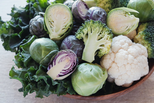 cruciferous vegetables, cauliflower,broccoli, Brussels sprouts, kale in wooden bowl, reducing estrogen dominance, ketogenic diet, plant based vegan food