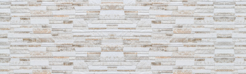 Panorama of Modern Brown and white stone wall pattern and background