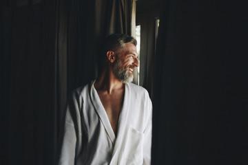 Cheerful man in a bathrobe