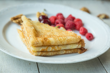 Delicious pancake with raspberry, walnuts and  cherries