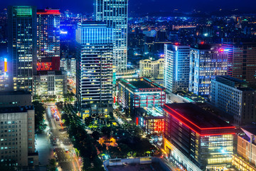 Asia Business concept for real estate and corporate construction - panoramic urban city skyline aerial view and tokyo station under twilight sky and neon night in Taipei, Taiwan