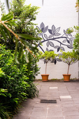courtyard with mural and potted plant